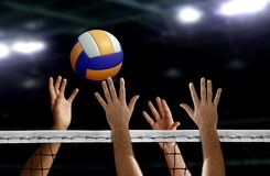 Volleyball spike hand block over the net. In a stadium Stock Photos
