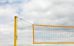 Volleyball summer sport. Net on a sandy beach Stock Photos