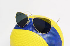 Volleyball and sunglasses Royalty Free Stock Photos
