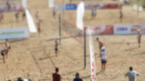 Volleyball tournament on the beach in summer stock footage