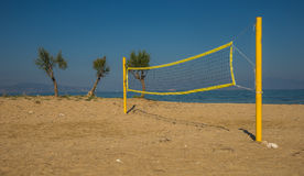 Volleyball tower and net on sandy beach Stock Photos