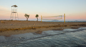 Volleyball tower and net on sandy beach Royalty Free Stock Images