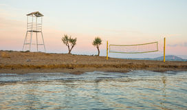Volleyball tower and net on sandy beach Royalty Free Stock Image