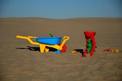 Volleyball toys. Plastic toys on the sandy beach Stock Photo