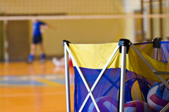 Volleyball training basket. Training basket full of volleyball balls at a gym stock photography