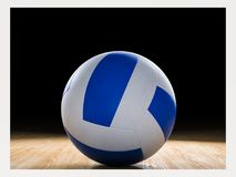 Volleyball on wooden court stock photography