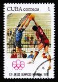 Volleybollspelare, serie ägnade till det 21. olympiska spel i Montreal, 1976, circa 1976 Arkivfoton