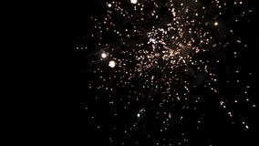 Volleys of fireworks in the night sky stock footage