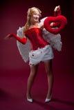 Vollkommener blonder Engel mit einem roten Inneren Lizenzfreies Stockbild