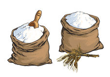 Vollkornbrotmehlsäcke mit hölzernen Schaufel und den Weizenähren Lizenzfreie Stockbilder