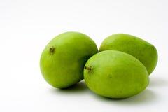 Vollständige grüne Mangofrucht drei Stockfotos