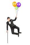Volo del mago in su negli aerostati della holding e dell'aria Fotografie Stock