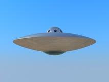Volo del UFO in cielo blu Fotografia Stock