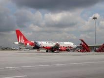 Volo dell'aeroplano di Air Asia Immagini Stock