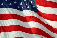 Volo della bandiera americana in brezza Fotografie Stock