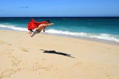 Volo di estate del supereroe fotografie stock
