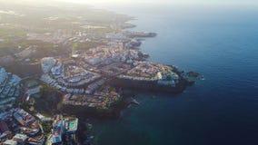 Volo sopra la città di Los Gigantes a Tenerife stock footage