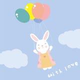 volo sveglio del coniglio sui palloni nel carretto del cielo Fotografia Stock