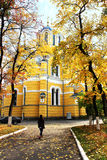 Volodymyrsky Cathedral among the trees in autumn leaves Stock Photos