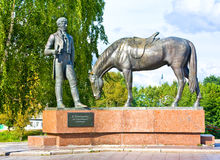 VOLOGDA, RUSSIA - AUGUST 15, 2016: Monument to the poet Konstantin Batyushkov. A man reading a book for a horse Stock Images