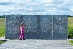 Little girl looks at the monument to 28 Panfilovtsi Royalty Free Stock Image