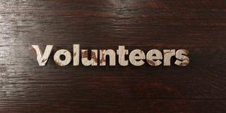 Volontaires - titre en bois sale sur l'érable - image courante gratuite de redevance rendue par 3D illustration libre de droits