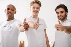 Volontari che mostrano i pollici su Fotografia Stock Libera da Diritti