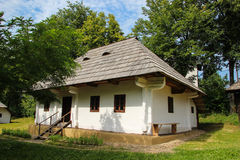 Volovat House at Suceava Village Museum. Traditional Romanian house from the Volovat village in Suceava county, built in the 19th century from timber beams with Royalty Free Stock Photography