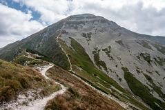Volovec mountain peak in Western Tatras mountains on slovakian-polish borders. From hiking trail bellow Derava peak during nice summer day with blue sky and stock photos