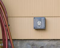240 volt outlet on exterior of house royalty free stock images