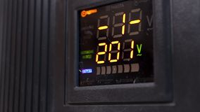 Voltage converter display during restart, close-up of power transformer booting. Stock footage stock footage