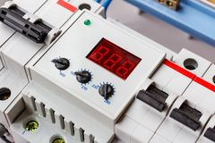 Voltage limiter installed in the white plastic mounting box closeup royalty free stock photography