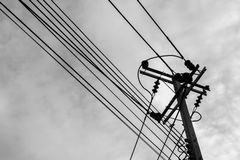 Voltage line on the sky background. Black and white filter Royalty Free Stock Photography
