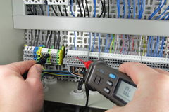 Voltage metering. Measuring device during voltage metering on a electrical panel Stock Photo