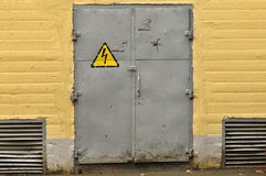 Voltage sign on metal door Stock Photography