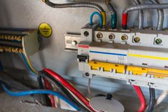 Voltage switchboard with circuit breakers are are in the ON position in the electric box. Electrical background. stock images