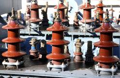 Voltage transformers in the highly polluting obsolete material d Stock Photography