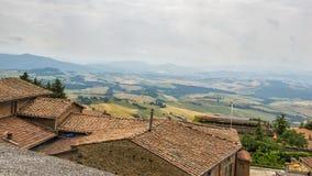Voltera Tuscany Italy View From Above. Voltera Tuscany Landscape June Tree Roofs stock photography