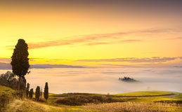 Volterra fog and sea of clouds, rolling hills panorama on sunset. Tuscany, Italy, Europe Royalty Free Stock Image