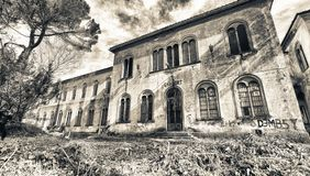 VOLTERRA, ITALY - FEBRUARY 24, 2018: Exterior view of Charcot bu. Ilding. It is part of the of abandoned asylum, closed in 1984 stock photo