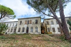 VOLTERRA, ITALY - FEBRUARY 24, 2018: Exterior view of Charcot bu. Ilding. It is part of the of abandoned asylum, closed in 1984 royalty free stock image