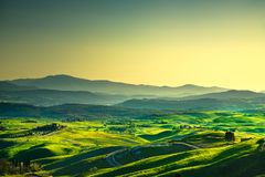 Volterra panorama, rolling hills, trees and green fields at suns Royalty Free Stock Photography