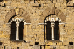 Volterra (Pisa) - Two mullioned windows Stock Photos
