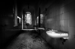 Volterra's sanitarium. Volterra, Italy - September 2016: Abandoned psychiatric hospital in Volterra. It was home to more than 6,000 mental patients but was shut stock image