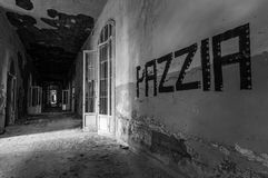Volterra's sanitarium. Volterra, Italy - September 2016: Abandoned psychiatric hospital in Volterra. It was home to more than 6,000 mental patients but was shut stock photos