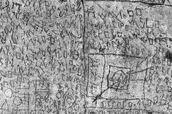 Volterra`s sanitarium. Volterra, Italy - September 2016: A mysterious series of runes, symbols and letters are scratched into the 180-metre-long courtyard walls stock photos