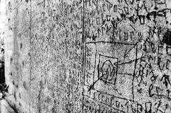 Volterra`s sanitarium. Volterra, Italy - September 2016: A mysterious series of runes, symbols and letters are scratched into the 180-metre-long courtyard walls royalty free stock image
