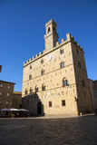 Volterra town central square, medieval palace Palazzo Dei Priori landmark, Pisa state, Tuscany, Italy royalty free stock photos
