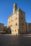 Volterra town central square, medieval palace Palazzo Dei Priori landmark. Pisa state, Tuscany, Italy, Europe Stock Image