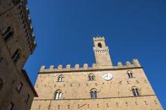 Volterra town central square, medieval palace Palazzo Dei Priori landmark Stock Photo